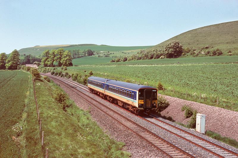 16th May '85:  Sprinter 155306 scoots along near Heytesbury