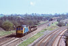 30th Mar '90:  As another stone train dissappears 33118 brings a short engineers train from the station