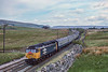 13th May 1989:  Starting the drop down from the Ais Gill summit is 47431 on the point of  'The Settle and Carlisle Express .  The distant photographers were all waiting  for the LNER V2 4771 'Green Arrow'  which was due  shortly afterwards.     '
