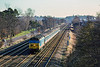 26th Feb 1989:  50041 'Bulwark' is working the 09.10 from Waterloo to Exeter through Pystock;  The station footbridge at Farnborough is just visible behind the distant signal gantries..
