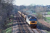 30th Mar 90:  47063 in Rail Freight Grey accelerates away from Virginia Water with ARC hoppers