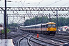12th May 1989:. On a rather wet afternoon 87024 'Lord of the Isles' is arriving at Carlisle with a Euston to Glasgow Express.  The lines on the left go to Newcastle and to the Sattle and Carlisle line.