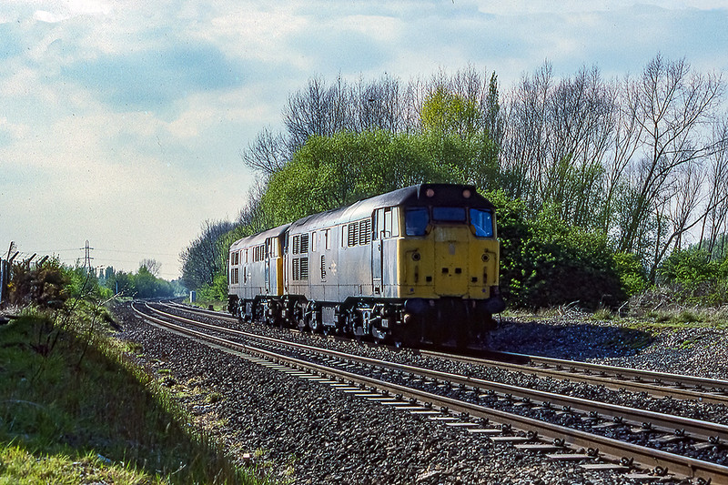 29th Apr 1990:  Heading East through Forge Mils are 31469 & 31402
