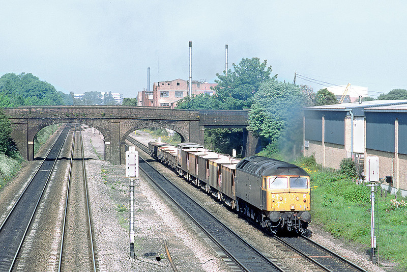 25th May 89:   47220 plods away from Dolphin Junction in Slough with an engineers train of ballast