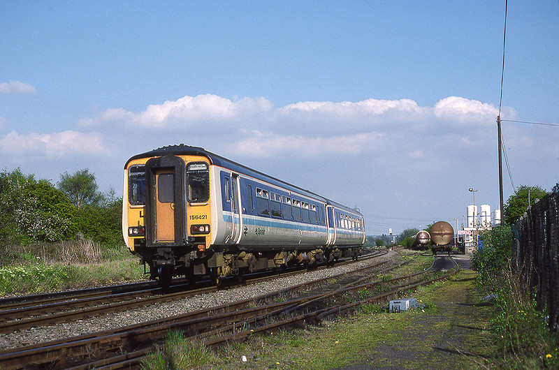 29th Apr 1990:  Sprinter 156421 is passing the cement depot sidings at Forge Mills as it works to Birmingham New Street from Nuneaton