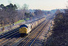 20th Feb 1989:  On the long straight between Farnborough and Fleet is 37708 with loaded oil tanks for the storage depot at Micheldever
