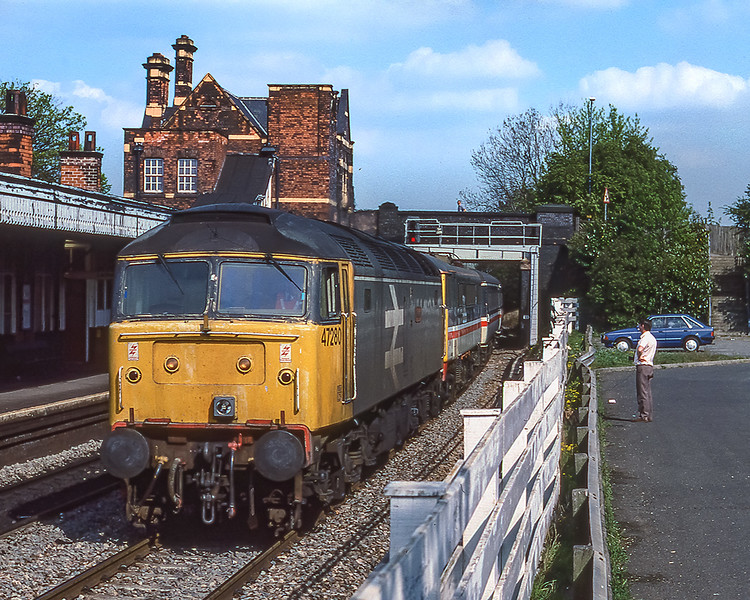 29th Apr 1990:  Because of closure on the WCML trains were being diverted..  At Water Orton 47280 rushes through is towing 86236 and it's train.