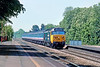 25th May 89:  50031 Hood makes a fine sight as it races up the main line through Taplow with a morning commuter service