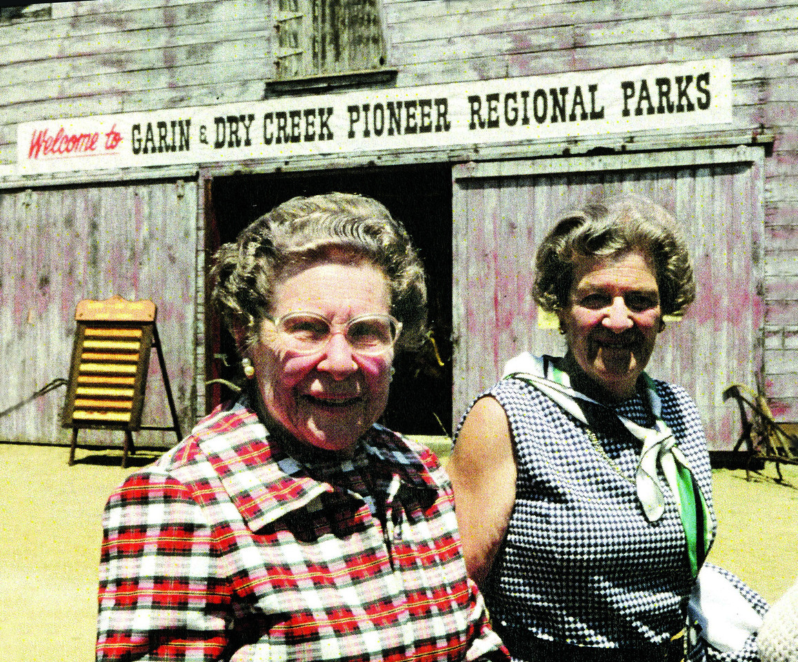 Then: In the late 1970s Mildred and Jeanette Meyers stand outside what is now the Garin Barn Visitor Center at Garin Regional Park in Hayward. With their sister, Dr. Edith Meyers, they bequeathed their adjacent 1,200 acre ranch to EBRPD and it became Dry Creek/Pioneer Regional Park.