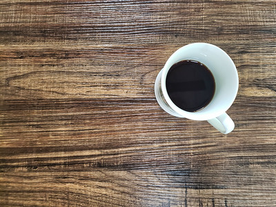 Coffee cup on wooden table, black coffee.
