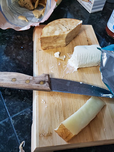 After party cheese block with knife and wrappers.