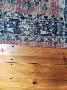 Background overhead photo of rug and hard wood floor