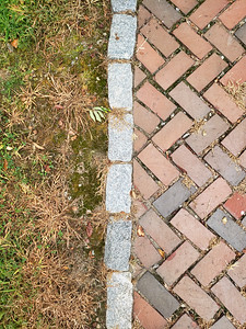 Grass, Brick, and Field stone background texture.