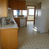 kitchen from main floor bath. Dean is in the sunroom in front of the washer and dryer.