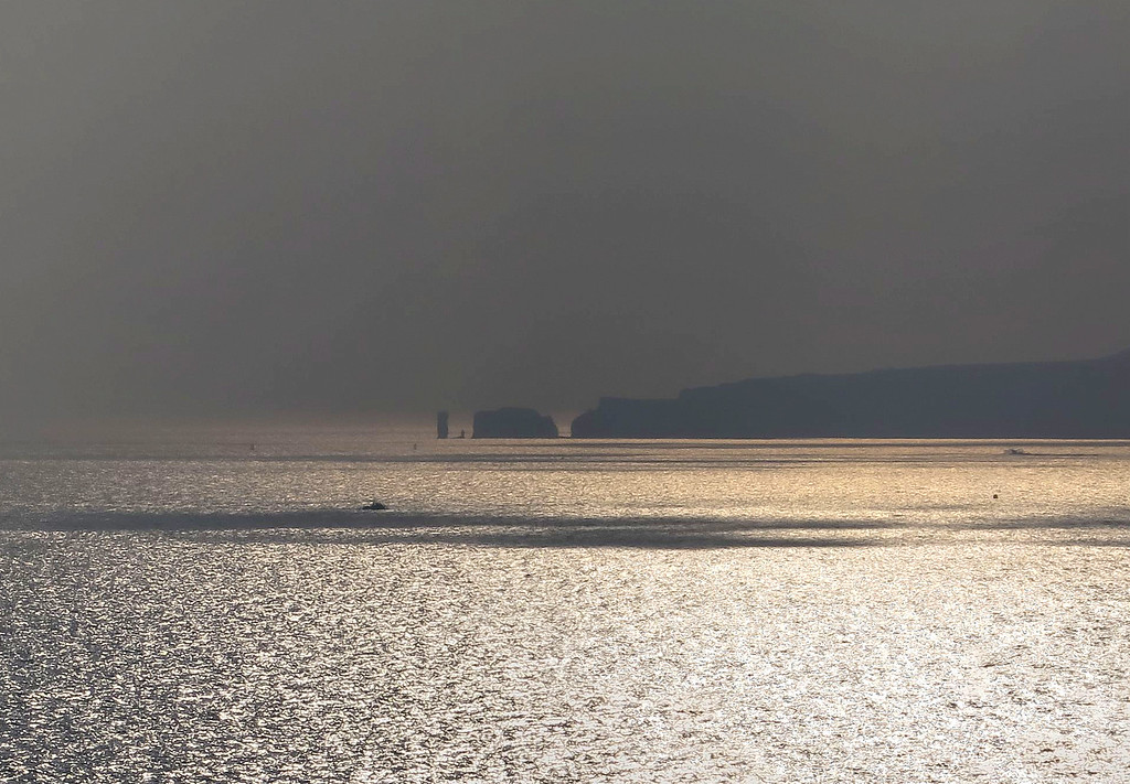 Old Harry lies brooding across the bay