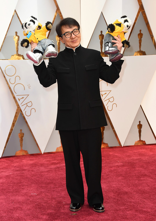 . Jackie Chan arrives at the Oscars on Sunday, Feb. 26, 2017, at the Dolby Theatre in Los Angeles. (Photo by Jordan Strauss/Invision/AP)