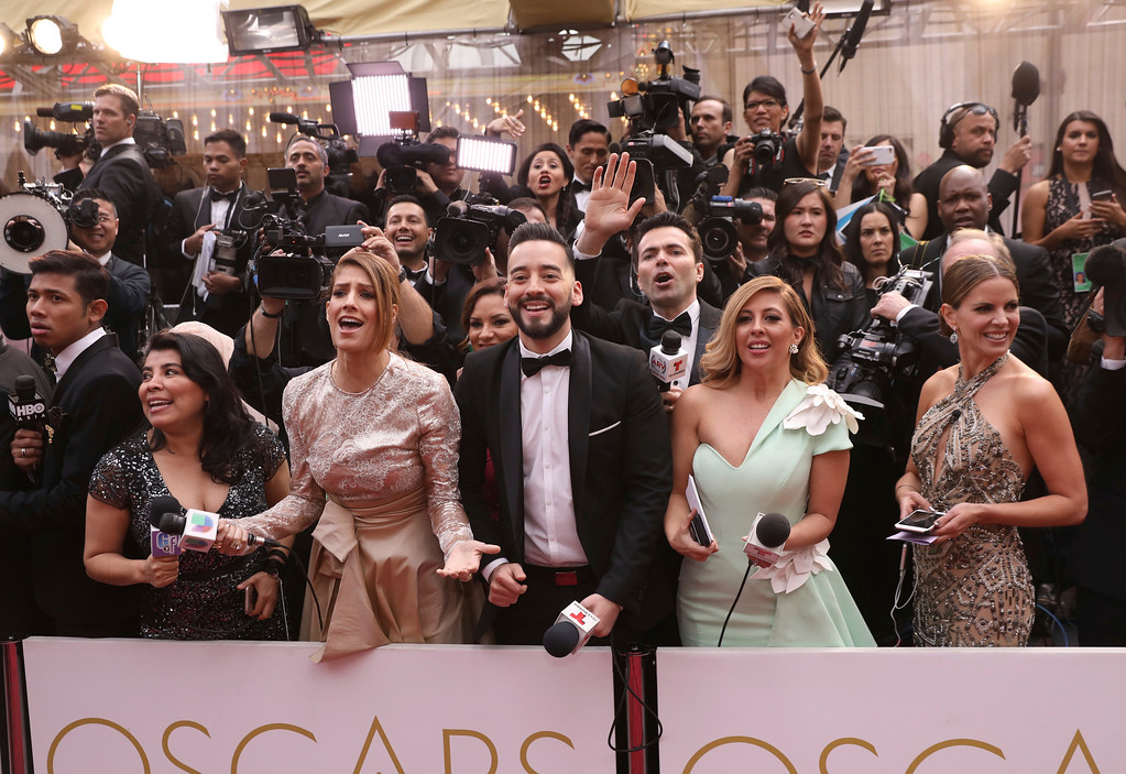 . Members of the press react as guests arrive at the Oscars on Sunday, Feb. 26, 2017, at the Dolby Theatre in Los Angeles. (Photo by Matt Sayles/Invision/AP)