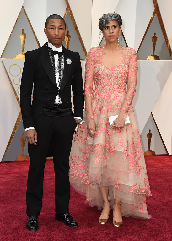. Pharrell Williams, left, and Mimi Valdes arrive at the Oscars on Sunday, Feb. 26, 2017, at the Dolby Theatre in Los Angeles. (Photo by Jordan Strauss/Invision/AP)