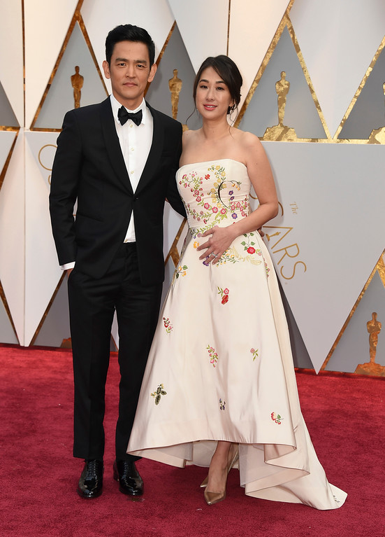 . John Cho, left, and Kerri Higuchi arrive at the Oscars on Sunday, Feb. 26, 2017, at the Dolby Theatre in Los Angeles. (Photo by Jordan Strauss/Invision/AP)