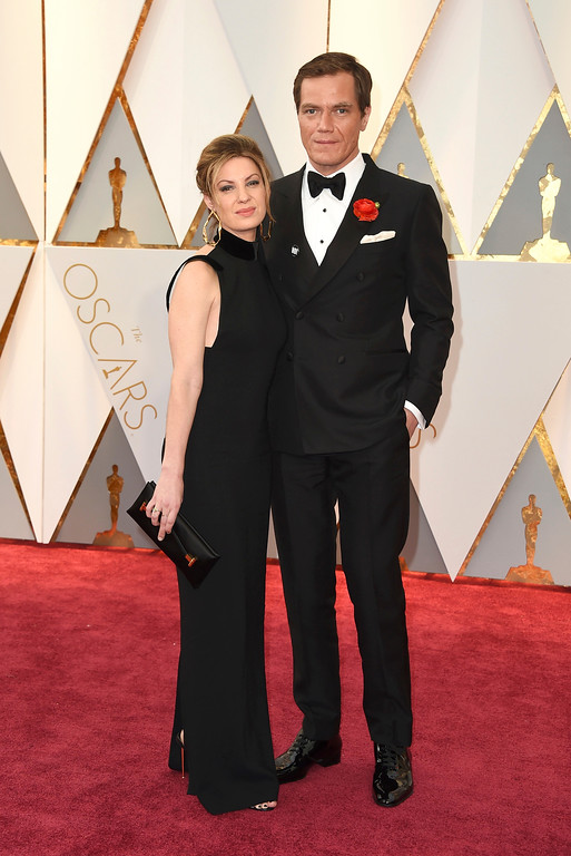 . Kate Arrington, left, and Michael Shannon arrive at the Oscars on Sunday, Feb. 26, 2017, at the Dolby Theatre in Los Angeles. (Photo by Jordan Strauss/Invision/AP)