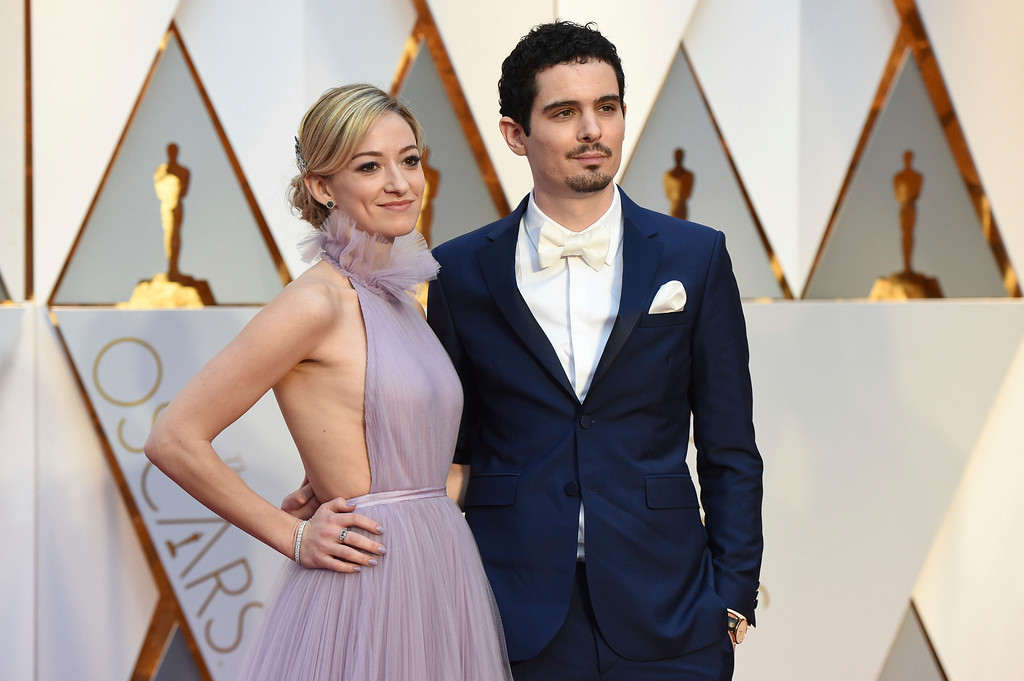 . Olivia Hamilton, left, and Damien Chazelle arrive at the Oscars on Sunday, Feb. 26, 2017, at the Dolby Theatre in Los Angeles. (Photo by Jordan Strauss/Invision/AP)