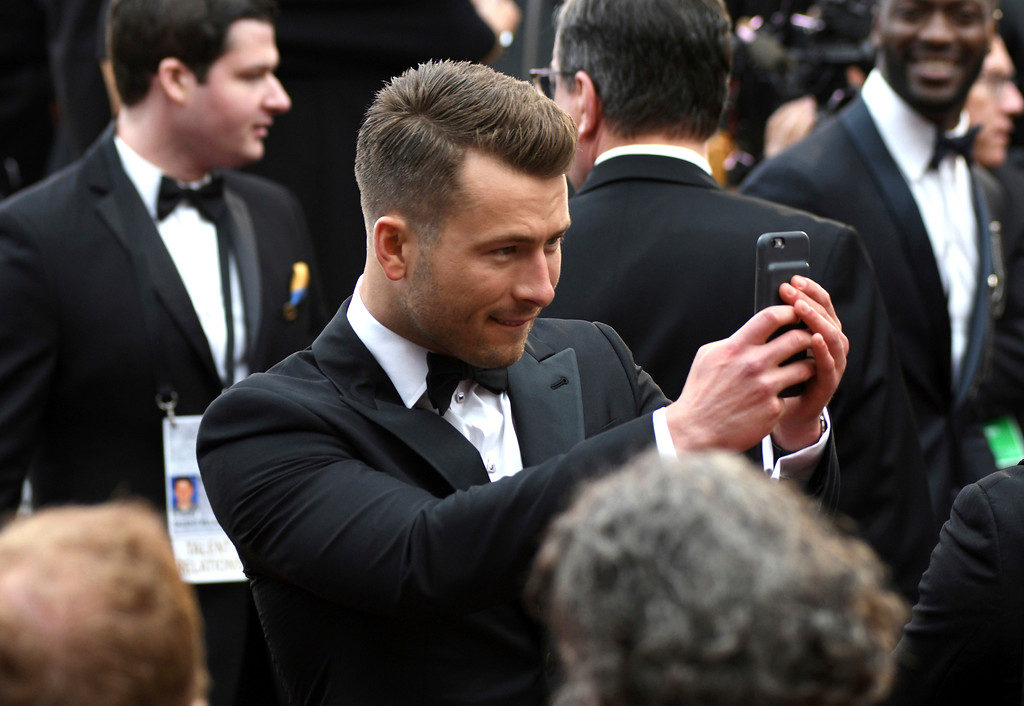 . Glen Powell arrives at the Oscars on Sunday, Feb. 26, 2017, at the Dolby Theatre in Los Angeles. (Photo by Al Powers/Invision/AP)