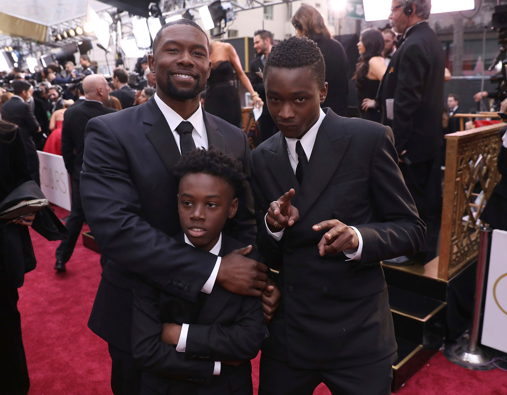. Trevante Rhodes, from left, Alex R. Hibbert and Ashton Sanders arrive at the Oscars on Sunday, Feb. 26, 2017, at the Dolby Theatre in Los Angeles. (Photo by Matt Sayles/Invision/AP)