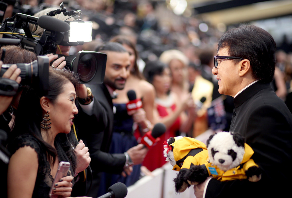 . Jackie Chan greets the press at the Oscars on Sunday, Feb. 26, 2017, at the Dolby Theatre in Los Angeles. (Photo by Matt Sayles/Invision/AP)