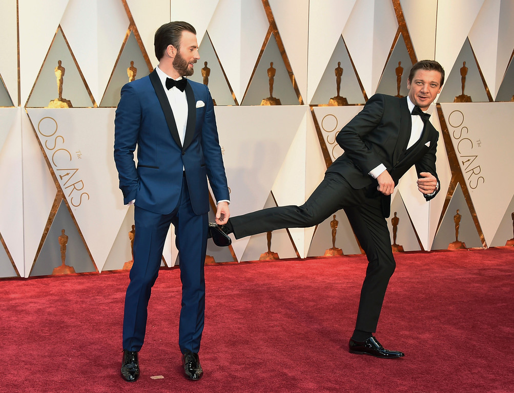 . Chris Evans, left, and Jeremy Renner arrive at the Oscars on Sunday, Feb. 26, 2017, at the Dolby Theatre in Los Angeles. (Photo by Jordan Strauss/Invision/AP)