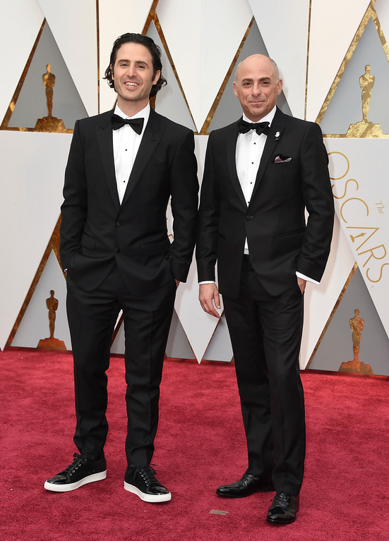 . Alan Barillaro, left, and Marc Sondheimer arrive at the Oscars on Sunday, Feb. 26, 2017, at the Dolby Theatre in Los Angeles. (Photo by Jordan Strauss/Invision/AP)