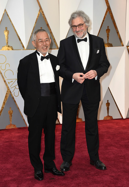 . Toshio Suzuki, left, and Michael Dudok de Wit arrive at the Oscars on Sunday, Feb. 26, 2017, at the Dolby Theatre in Los Angeles. (Photo by Jordan Strauss/Invision/AP)