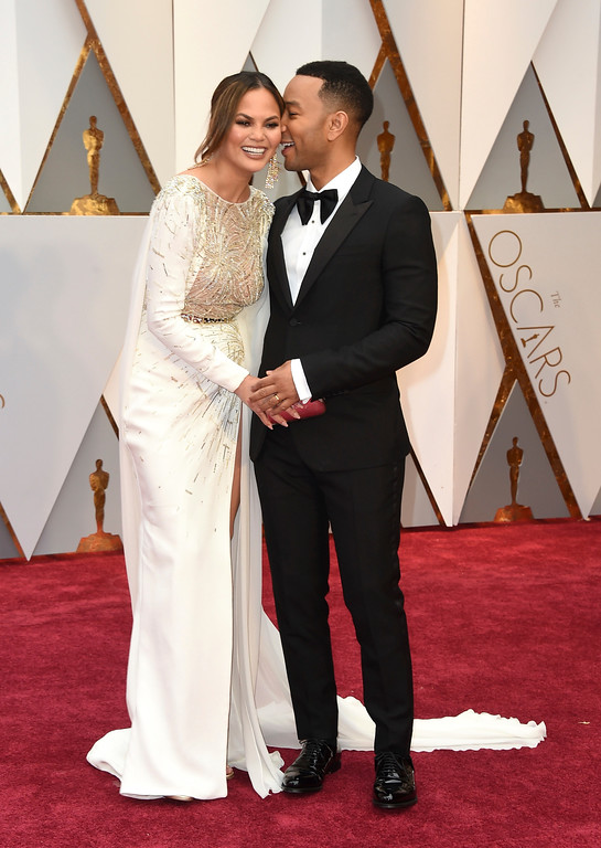 . Chrissy Teigen, left, and John Legend arrive at the Oscars on Sunday, Feb. 26, 2017, at the Dolby Theatre in Los Angeles. (Photo by Jordan Strauss/Invision/AP)