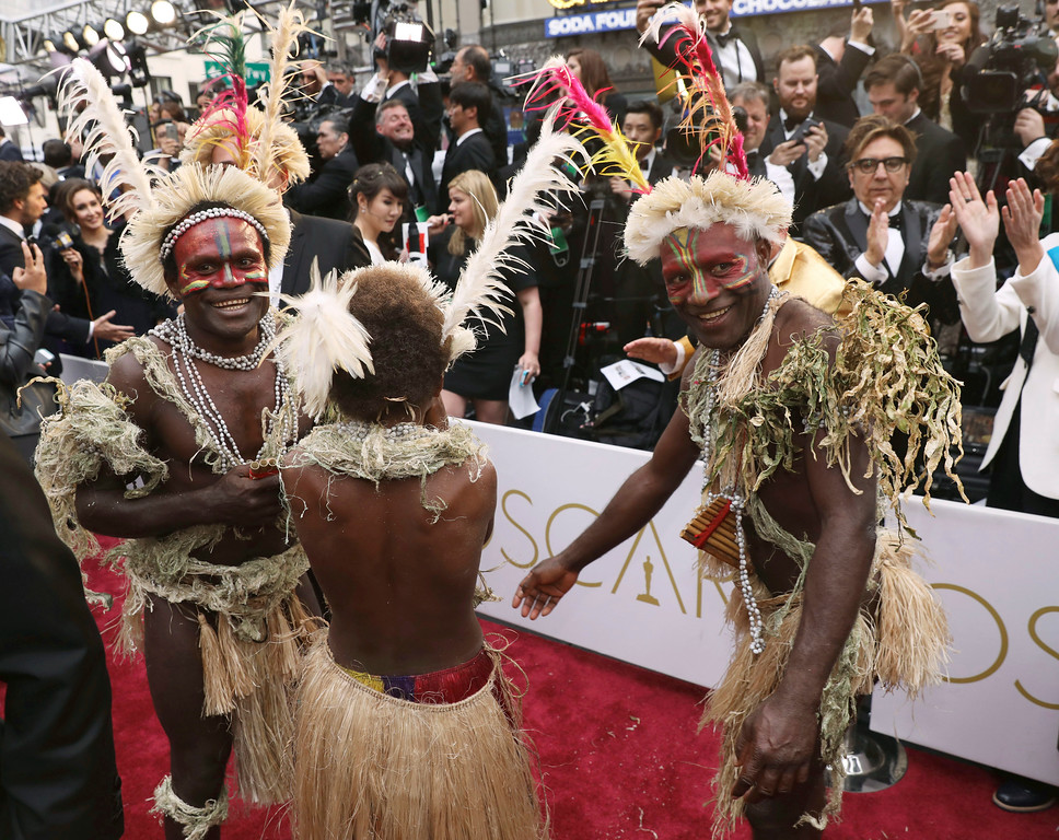 ". Members from the cast of ""Tanna\"" arrive at the Oscars on Sunday, Feb. 26, 2017, at the Dolby Theatre in Los Angeles. (Photo by Matt Sayles/Invision/AP)"