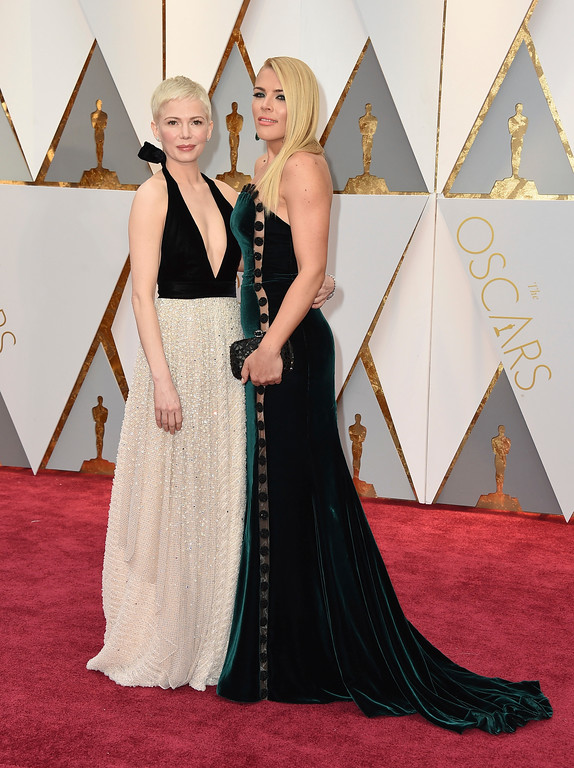 . Michelle Williams, left, and Busy Philipps arrive at the Oscars on Sunday, Feb. 26, 2017, at the Dolby Theatre in Los Angeles. (Photo by Jordan Strauss/Invision/AP)