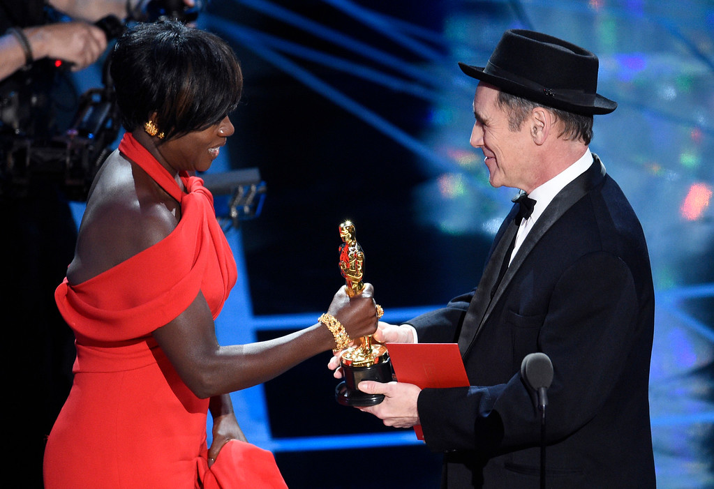 """. Mark Rylance, right, presents Viola Davis with the award for best actress in a supporting role for \""""Fences\"""" at the Oscars on Sunday, Feb. 26, 2017, at the Dolby Theatre in Los Angeles. (Photo by Chris Pizzello/Invision/AP)"""