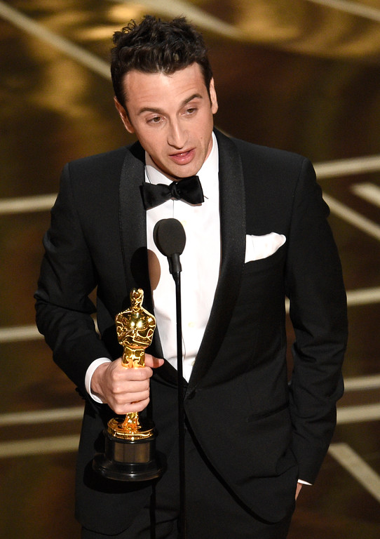 """. Justin Hurwitz accepts the award for best original score for \""""La La Land\"""" at the Oscars on Sunday, Feb. 26, 2017, at the Dolby Theatre in Los Angeles. (Photo by Chris Pizzello/Invision/AP)"""