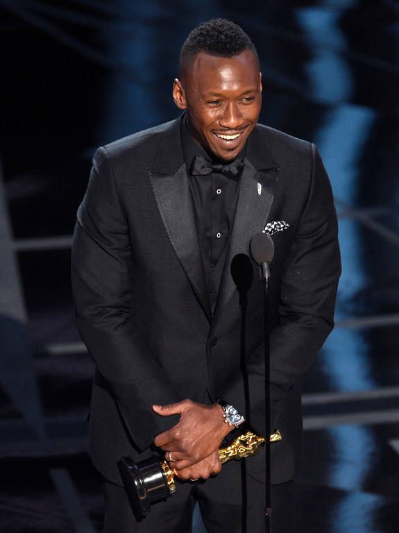 ". Mahershala Ali accepts the award for best actor in a supporting role for ""Moonlight\"" at the Oscars on Sunday, Feb. 26, 2017, at the Dolby Theatre in Los Angeles. (Photo by Chris Pizzello/Invision/AP)"