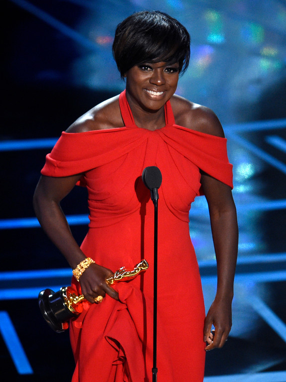 ". Viola Davis accepts the award for best actress in a supporting role for ""Fences\"" at the Oscars on Sunday, Feb. 26, 2017, at the Dolby Theatre in Los Angeles. (Photo by Chris Pizzello/Invision/AP)"