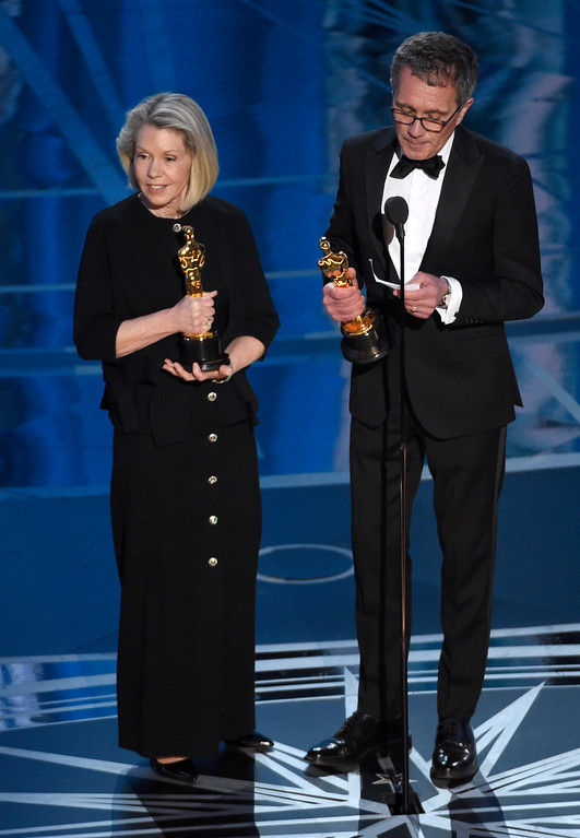 ". Sandy Reynolds-Wasco, left, and David Wasco accept the award for best production design for ""La La Land\"" at the Oscars on Sunday, Feb. 26, 2017, at the Dolby Theatre in Los Angeles. (Photo by Chris Pizzello/Invision/AP)"