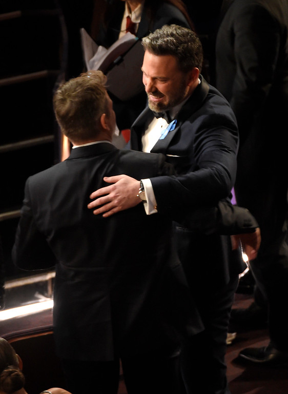 . Matt Damon, left, and Ben Affleck appear in the audience at the Oscars on Sunday, Feb. 26, 2017, at the Dolby Theatre in Los Angeles. (Photo by Chris Pizzello/Invision/AP)