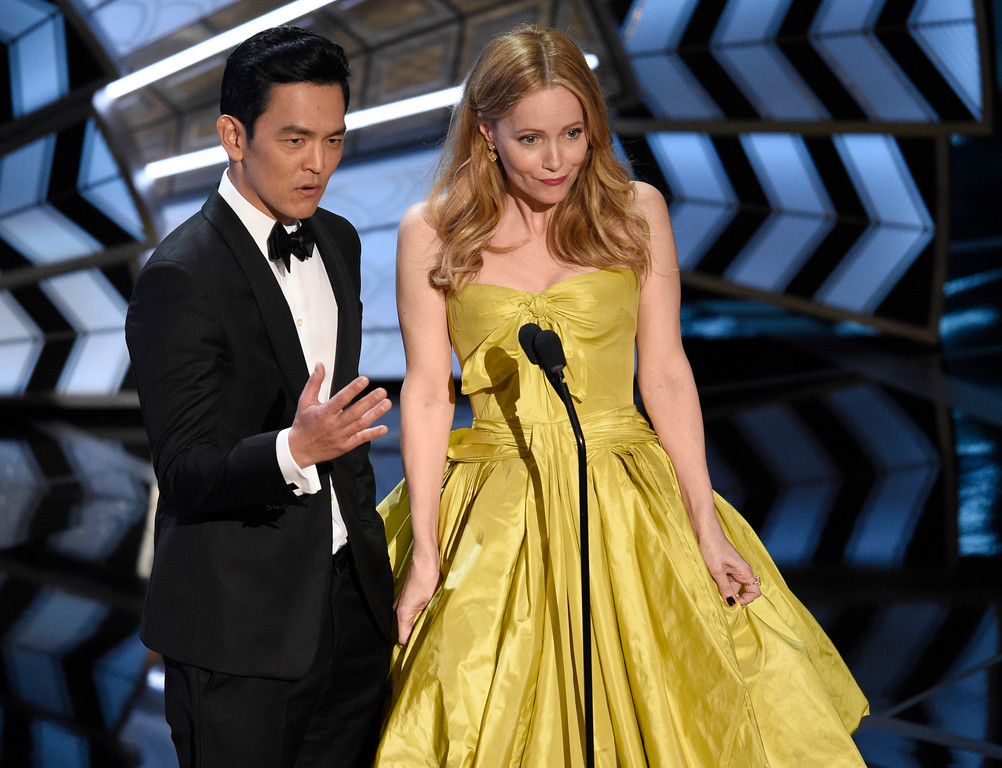 . John Cho, left, and Leslie Mann speak at the Oscars on Sunday, Feb. 26, 2017, at the Dolby Theatre in Los Angeles. (Photo by Chris Pizzello/Invision/AP)