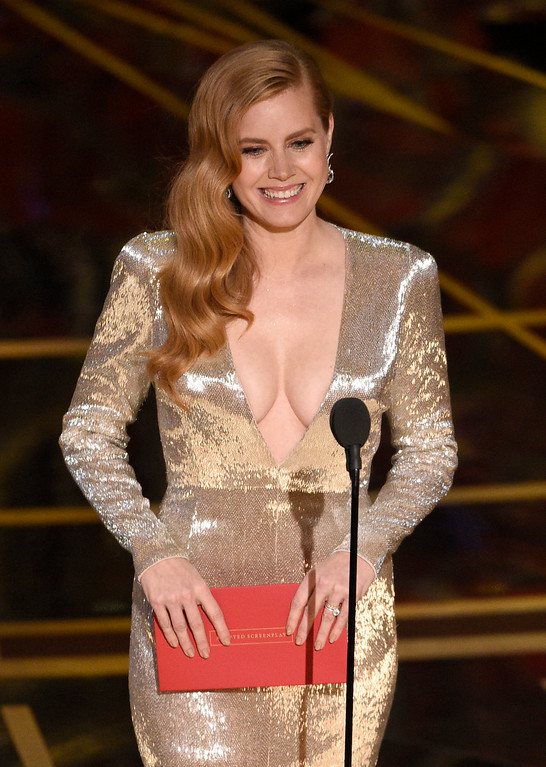 . Amy Adams presents the award for best adapted screenplay at the Oscars on Sunday, Feb. 26, 2017, at the Dolby Theatre in Los Angeles. (Photo by Chris Pizzello/Invision/AP)