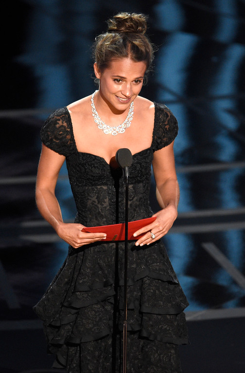 . Alicia Vikander presents the award for best actor in a supporting role at the Oscars on Sunday, Feb. 26, 2017, at the Dolby Theatre in Los Angeles. (Photo by Chris Pizzello/Invision/AP)