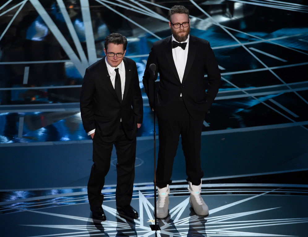 . Michael J. Fox, left, and Seth Rogen present the award for best film editing at the Oscars on Sunday, Feb. 26, 2017, at the Dolby Theatre in Los Angeles.(Photo by Chris Pizzello/Invision/AP)