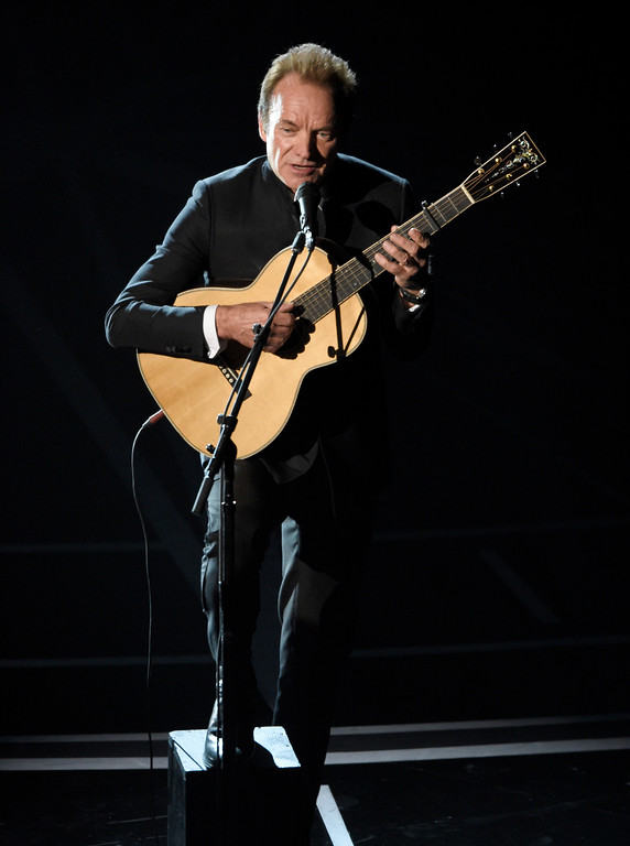 """. Sting performs best original song nominee \""""The Empty Chair\"""" from \""""Jim: The James Foley Story\"""" at the Oscars on Sunday, Feb. 26, 2017, at the Dolby Theatre in Los Angeles. (Photo by Chris Pizzello/Invision/AP)"""
