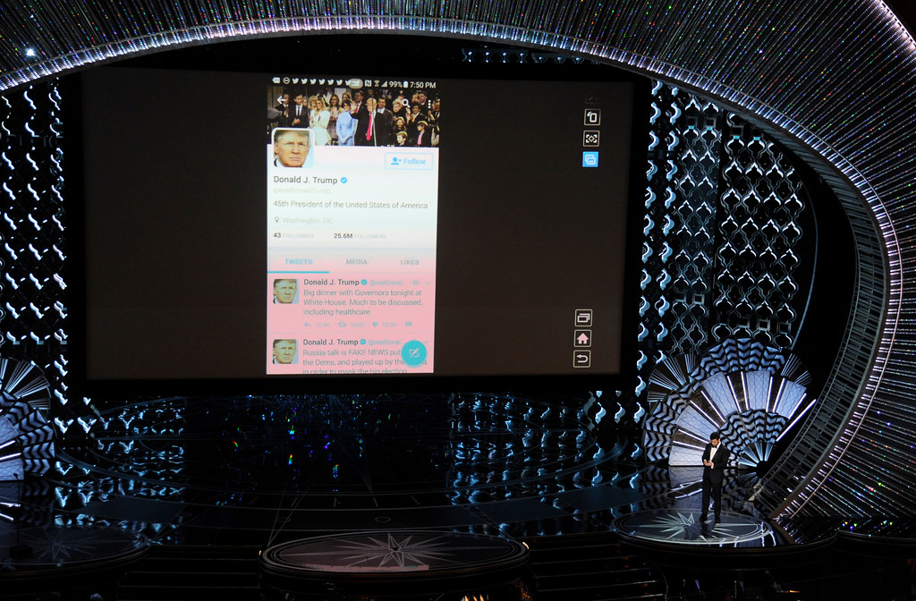 . Host Jimmy Kimmel tweets President Donald Trump on stage at the Oscars on Sunday, Feb. 26, 2017, at the Dolby Theatre in Los Angeles. (Photo by Chris Pizzello/Invision/AP)