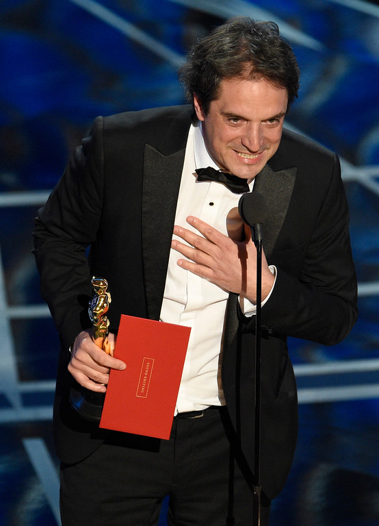 """. Sylvain Bellemare accepts the award for best sound editing for \""""Arrival\"""" at the Oscars on Sunday, Feb. 26, 2017, at the Dolby Theatre in Los Angeles. (Photo by Chris Pizzello/Invision/AP)"""