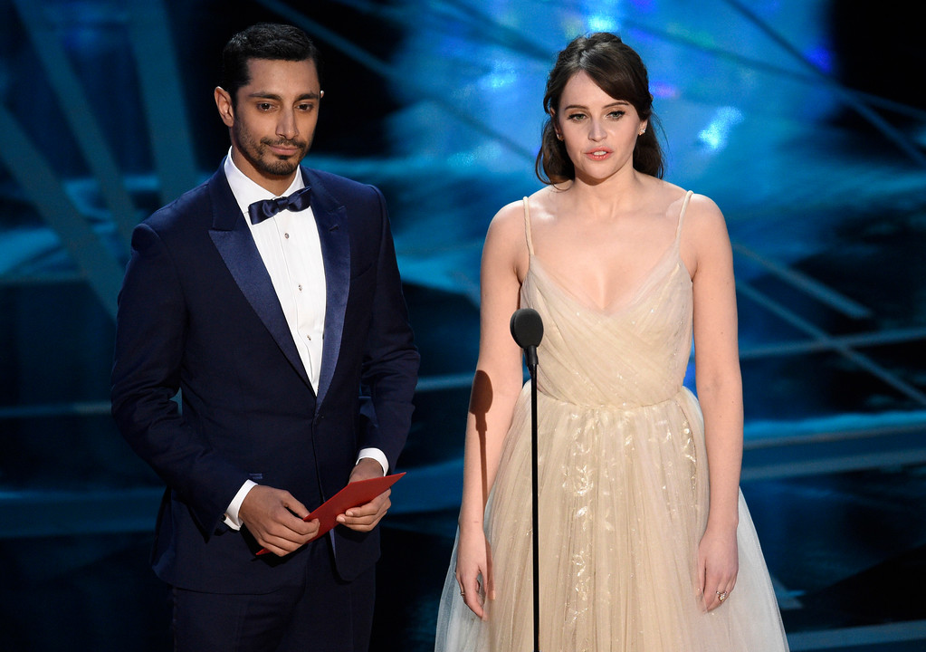 . Riz Ahmed, left, and Felicity Jones present the award for best visual effects at the Oscars on Sunday, Feb. 26, 2017, at the Dolby Theatre in Los Angeles. (Photo by Chris Pizzello/Invision/AP)