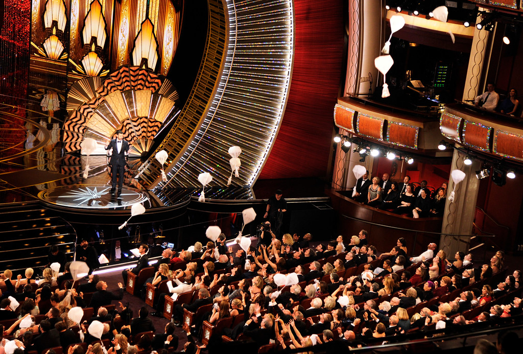 . Host Jimmy Kimmel speaks as donuts fall onto the audience at the Oscars on Sunday, Feb. 26, 2017, at the Dolby Theatre in Los Angeles. (Photo by Chris Pizzello/Invision/AP)