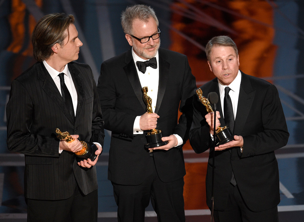 """. Byron Howard, from left, Rich Moore, and Clark Spencer accepts the award for best animated feature film for \""""Zootopia\"""" at the Oscars on Sunday, Feb. 26, 2017, at the Dolby Theatre in Los Angeles. (Photo by Chris Pizzello/Invision/AP)"""